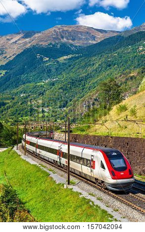 Faido, Switzerland - September 25, 2016: Swiss RABDe 500 tilting high-speed train on the Gotthard railway. The traffic will be diverted to the Gotthard Base Tunnel in December 2016.
