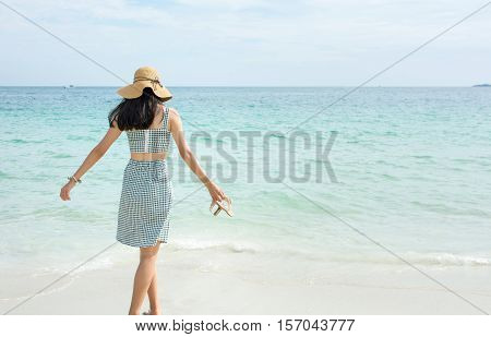 Woman Walking Towards The Sea Water
