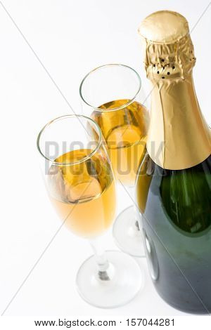 Champagne bottle and cups isolated on white background