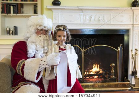 Little girl with missing front teeth asking Santa for gifts