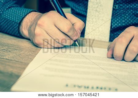 Businessman is signing a contract to conclude a deal - retro style