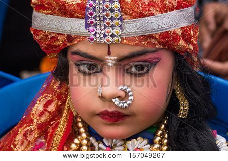 KOLKATA, INDIA - JANUARY 31, 2016: Sweet Indian girl in fancy dress attire (portrait) dressed as Indian Maharajah (King) at the Statesman Vintage Car rally at the Fort William, Kolkata.