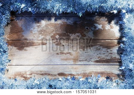 close up view of christmas tree garland on wooden back