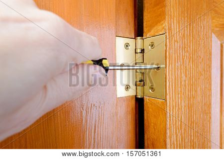 Adjusting A Door Hinge