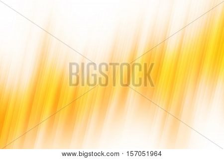 Orange blurred rays of light blend to create abstract background
