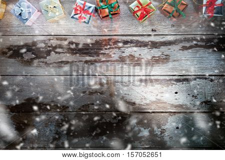 close up view of christmas  gift boxes  on wooden back