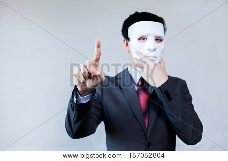 Anonymous Businessman In Mask Hiding Himself Touching On Virtual Screen - With Copyspace