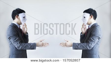 Two Men In Business Suit Handshaking With Masks On - Business Fraud And Hypocrite Agreement