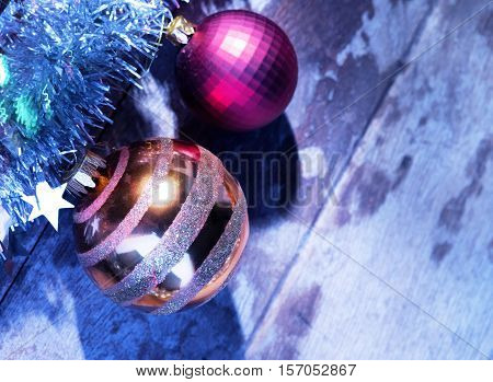 close up view of fragment of decorated Christmas tree on wooden back