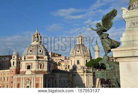 View of the Trajan's Forum twin churches dedicated to Virgin Mary from Vittoriano monument with renaissance and baroque domes in front of ancient victory column