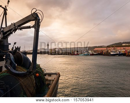 SCARBOROUGH ENGLAND - NOVEMBER 5: Scarborough fishing docks with trawler in foreground. In Scarborough England. On 5th November 2016.