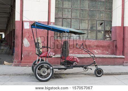 Rickshaw or tuk tuk taxi parked in Havana, Cuba