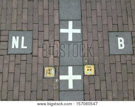 Border marking on the street pavement separating Baarle-Hertog into Belgian and Dutch territories
