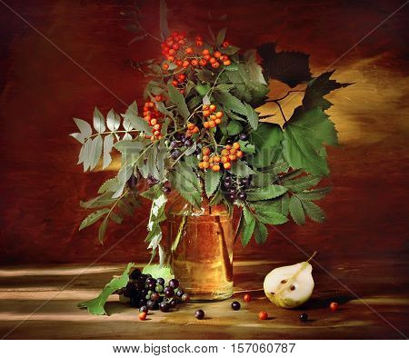 Autumn still life with rowanberry and pear in rustic style