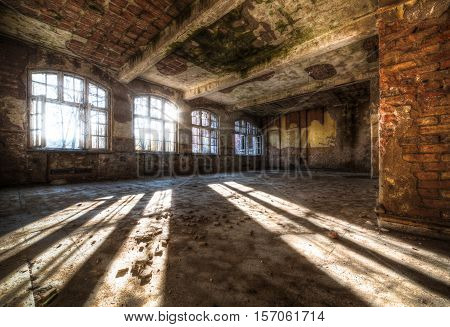 Old Abandoned Room Of Rays Of Light Through The Window. The Old Mysterious Building