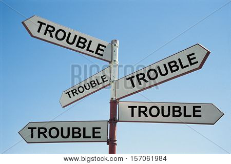 Metal Sign Post with Text Saying trouble