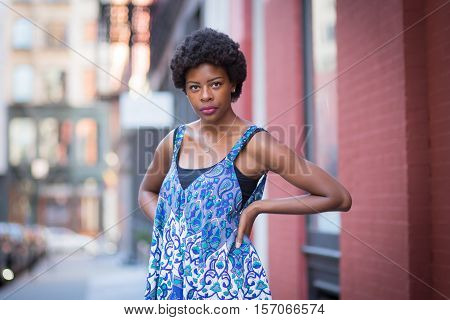 Street portrait of young fashionable African American woman. Photographed in Soho NYC.