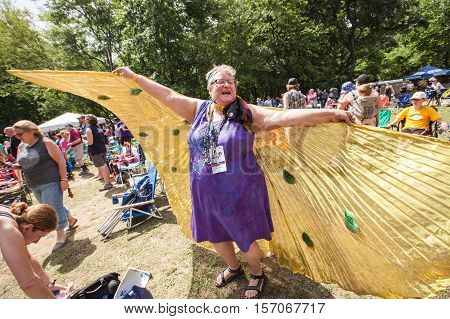 Woman In Angel Wings At The Wild Goose Festival