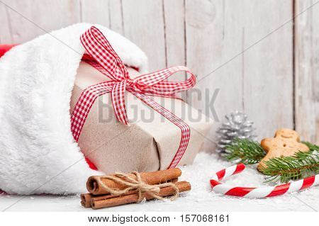 Christmas Presents With Snow On Wooden Background