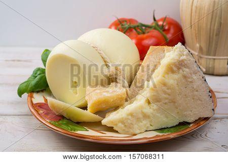 Best Italian food - fresh caciocavallo pecorino parmesan cheese on ceramic plate