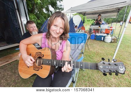 Woman Playing Guitar At The Wild Goose Festival