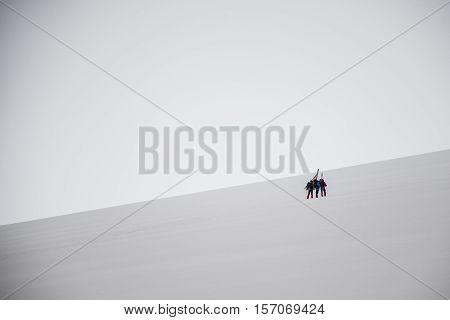 Group Hiking the glacier Hvannadalshnukur highest summit in Iceland mountain landscape Vatnajokull park