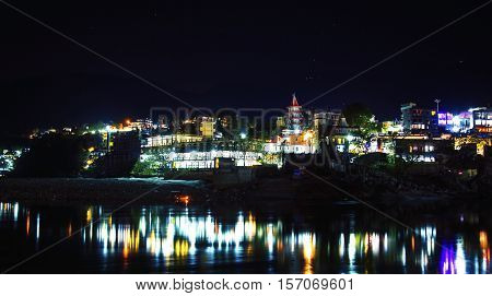 Rishikesh at night, view to Ganga river and city lights, India