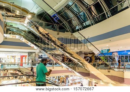ABU DHABI - NOVEMBER 4 2016: Luxury glass interior shopping center Marina mall in Abu Dhabi UAE. Marina Mall is Abu Dhabi's premium shopping mall and entertainment landmark. Marina Mall. Abu Dhabi. AEU