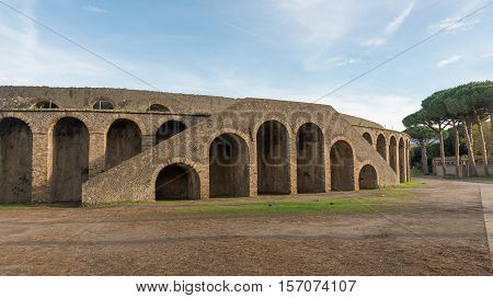 POMPEI ITALY- NOVEMBER 13: Pompeii was declared in 1997 by UNESCO World Heritage Site with about 3 million visitors last year. Visible Architecture amphitheater on november 13 2016 in Pompeii - Italy