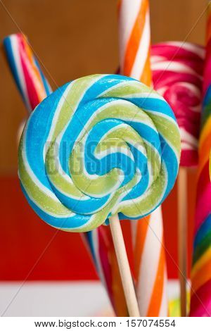 Multicolored sweet candy canes and twirls on wooden sticks variety