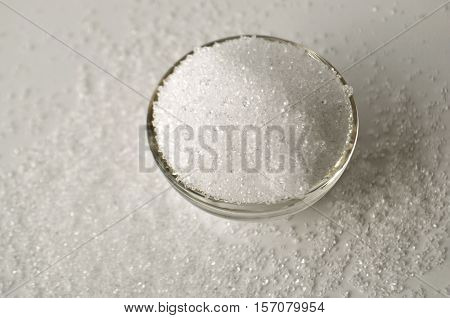 Xylitol sweetener - sugar substitute - crystals in a glass bowl top view with copy space