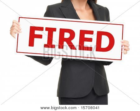 Fired. Unemployed business woman holding sign board on white saying