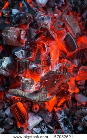 Burning coals. Decaying charcoal. Texture embers closeup. burning charcoal in the background