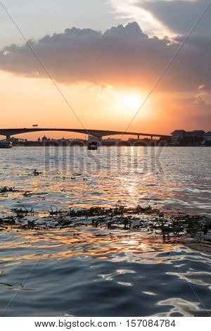 Boat view from Chao Praya river on Bangkok during beautiful sunset, Thailand