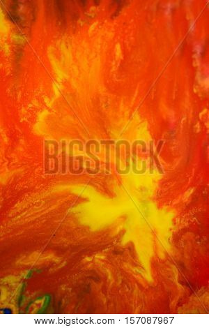 Red, yellow fluid chaotic mix of colors macro. Abstract color creative art background basis closeup.