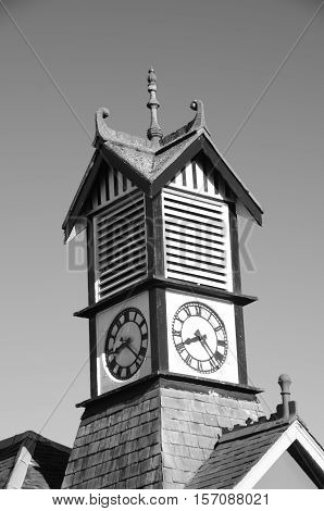 A view of a rooftop clock tower in Thornton