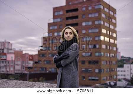 Blond Fashion Woman Standing Outdoor Against Skyscaper