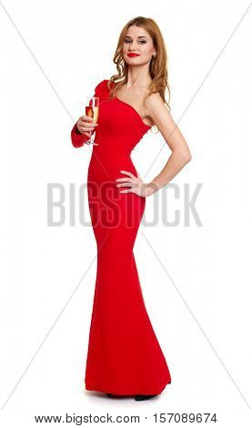 beautiful girl in red gown with champagne isolated on white background, winter holiday concept