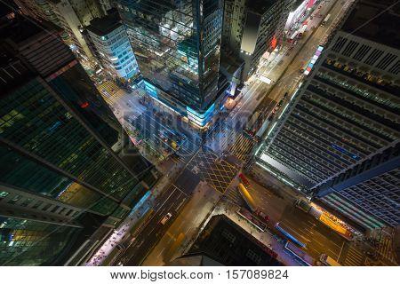 Skyscrapers and road at night in Hong Kong city, China, top view