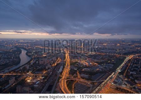 Highways, tall buildings, river at evening in Moscow, Russia, panoramic view
