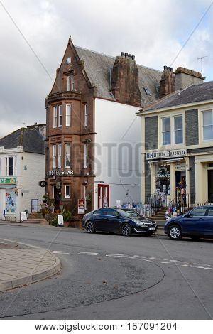 MOFFAT, UK - NOVEMBER 5, 2016: The star hotel, recorded in the Guinness book of records as the worlds narrowest hotel at 20ft wide, and a traditional hardware shop, Moffat, Scotland, UK
