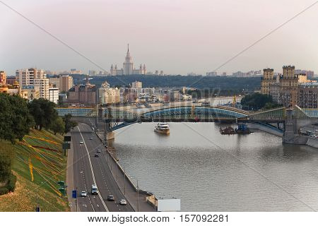 Bogdan Khmelnitsky bridge, river, ships and quay at summer day in Moscow