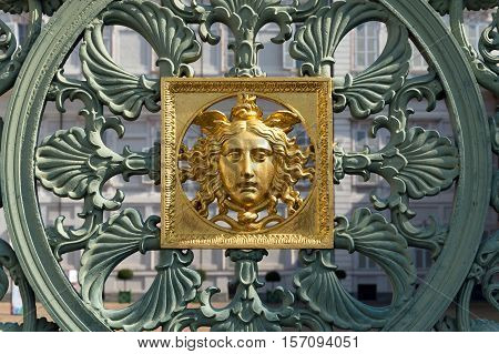 TURIN, ITALY - AUGUST 27, 2016: Detail of the gates of Royal Palace in Piazza Castello