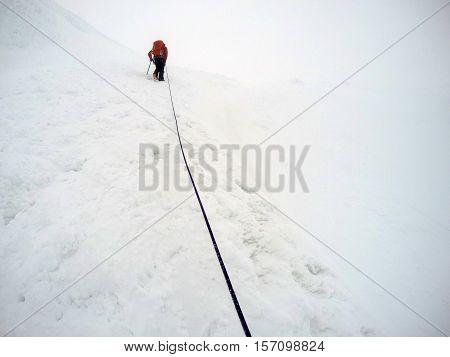 Men Hiking the glacier Hvannadalshnukur highest summit in Iceland mountain landscape Vatnajokull park 4