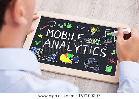 Businessperson Drawing Mobile Analytic Concept On Slate