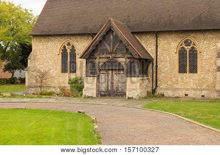 Stone church with beautiful old wooden doors