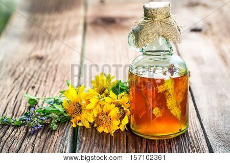 Healthy Tincture In Bottles With Herbs And Alcohol