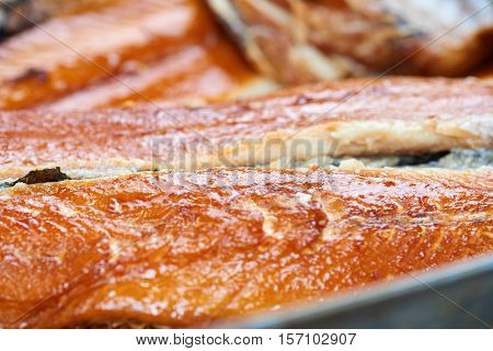 Smoked fish in a tin pan. Smoked herring