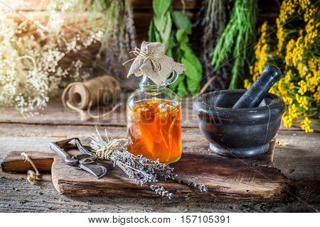 Therapeutic Tincture As Natural Medicine On Old Wooden Table