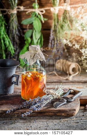 Therapeutic Tincture As Homemade Cure On Old Wooden Table